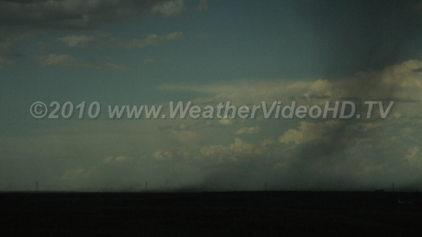 Microburst Blowing dust from virga from approaching storm