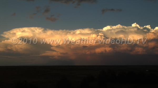 Distant Thunderheads A developing mesoscale convective system at sunset