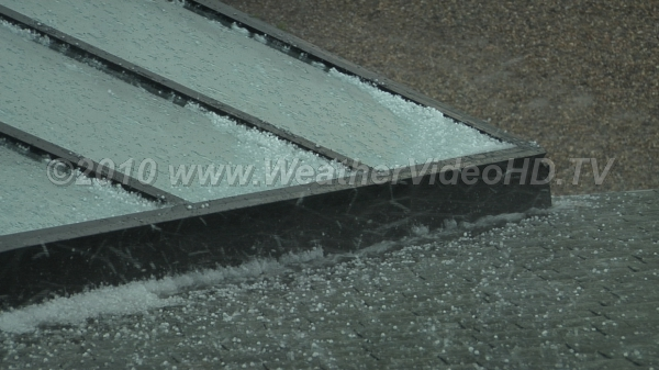 Hail drifts Pea size hail begins to drift and pile up on a roof; such drifts can reach feet deep along drainages