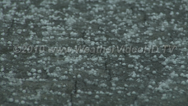 Hail Hail Pea size hail pelts a roof; generally hail must be 0.75 to 1.00 inch to cause damage
