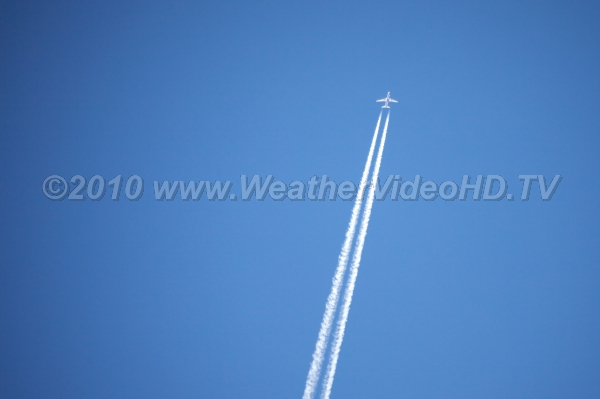 Fresh Contrail Twin engine jet produces dual contrails