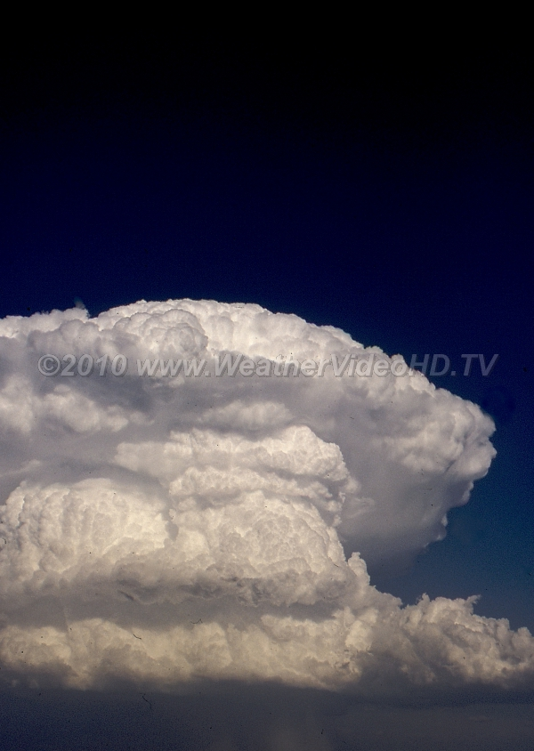 Supercell Tower Intense updrafts mark the rear flank of rapidly developing supercell