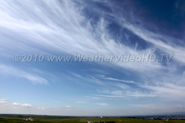 Feathery Cirrus Streaks of ice crystals fall through the upper troposphere