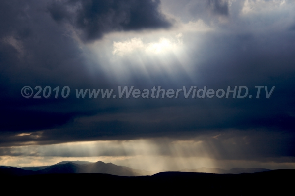 A Break in the Storm Crepuscular rays bathe a valley after a summer storm begins to clear out