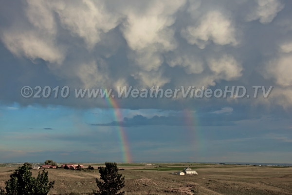 Mammatus & Rainbows Virga descending from anvil allow for a double rainbow