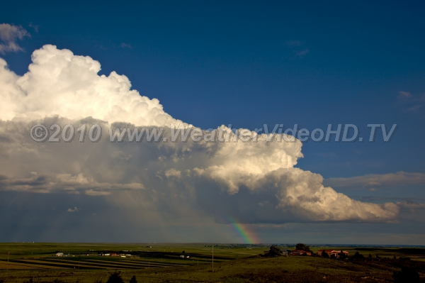 Supercell with Rainbow Low-precipitation supercell strongly leaning due to intense vertical wind shear