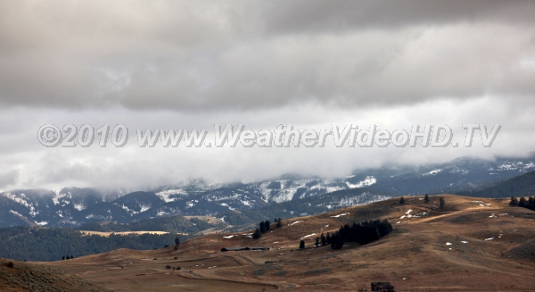 Winter Approaches A cold frontal system begins coating the higher elevations of the northern Rockies with snow