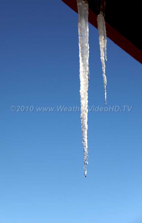 Icicle Icicle formation happens with sun melting snow in one region but sub-freezing shade remains in another