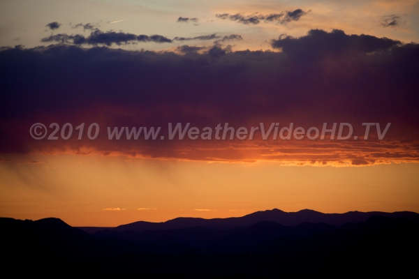Orange Sprinkle A dash of light rain and virga fall from a middle layer cloud deck at sunset