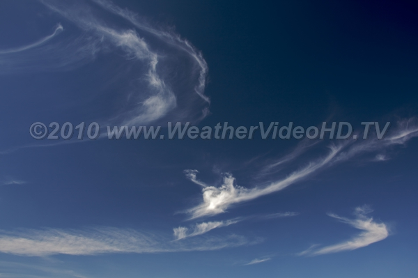 Feathery Cirrus Ice crystal clouds swirled by high level wind shears
