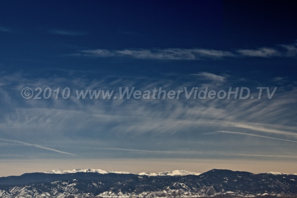 Cirrus Over The Rockies Jet stream winds passing over mountains show ripples and waves