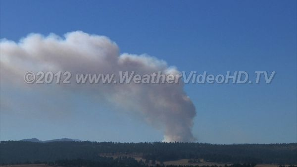 Uncontrolled Burn Wind and shear contort the massive plume of smoke from a Black Hills Forest fire.