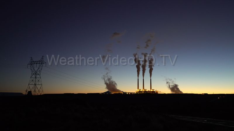 Power Plant at Dawn A new day dawning in the Arizona Desert frames the Navajo Generating Station and its cooling tower and stack plumes.
