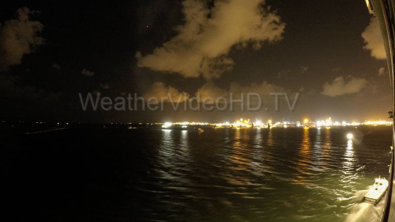 Clouds over Suez Canal at Night Sailing southbound on the Suez Canal at night while cumulus clouds drift overhead