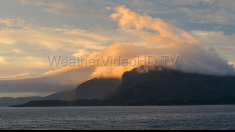 Orographic Stratus Wildly turbulent stratus clouds stream down a western Norway fjord in the strange evening light of the near midnight sun of late May